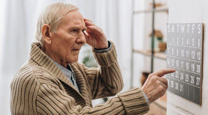 Senior Man Looking At Calendar